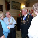 Photo:The Mayor (David Smith)  talking to Bob Cristofoli and other members of our group in the Town Hall foyer.
