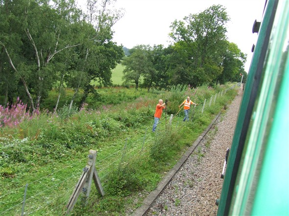 Photo:Trackside workers clearing away vegitation