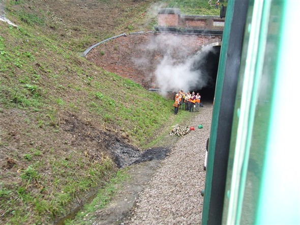 Photo:Workmen at the entrance to Sharpthorne Tunnel, the longest railway tunnel presently in preservation