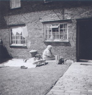 Photo:Ernest Marchant, aged about 20, with mum Ethel in the garden of 4 Twineham Road, c1958